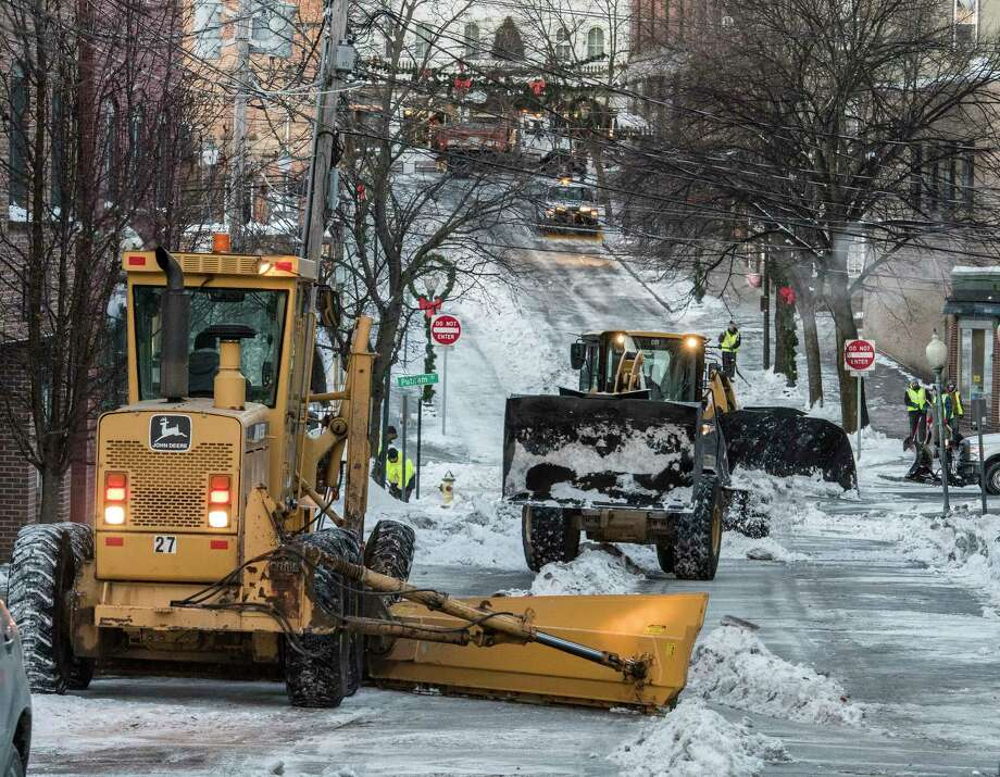 Saratoga Springs DPW workers remove snow from the sides of Phila Street Thursday Dec 28, 2017. While the city, like others in the Capital Region, are struggling with water main breaks, on Wednesday Spa City's DPW was busy with snow removal.  (Skip Dickstein/ Times Union) Photo: SKIP DICKSTEIN / 20042523A