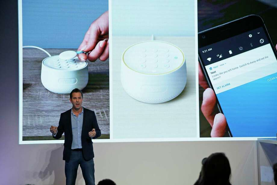 FILE - In this Wednesday, Sept. 20, 2017, file photo, Maxime Veron, head of product marketing for Nest Labs, talks about the features of the Nest Secure alarm system during an event in San Francisco. As people get voice-activated speakers and online security cameras for convenience and peace of mind, are they also giving hackers a key to their homes? Many devices from reputable manufacturers have safeguards built in, but safeguards aren't the same as guarantees. (AP Photo/Eric Risberg, File) Photo: Eric Risberg / Copyright 2017 The Associated Press. All rights reserved.