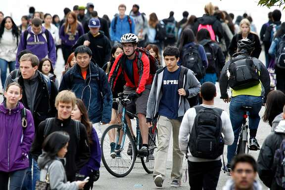 In this photo taken Oct. 23, 2012,  University of Washington students walk on the campus between classes in Seattle. While marijuana use is about to become legal in Washington and Colorado, that won't mean it will be welcome at the states' colleges and universities. Instead, federal laws and college rules of conduct will combine to keep pot illegal on campuses. (AP Photo/Elaine Thompson, File)