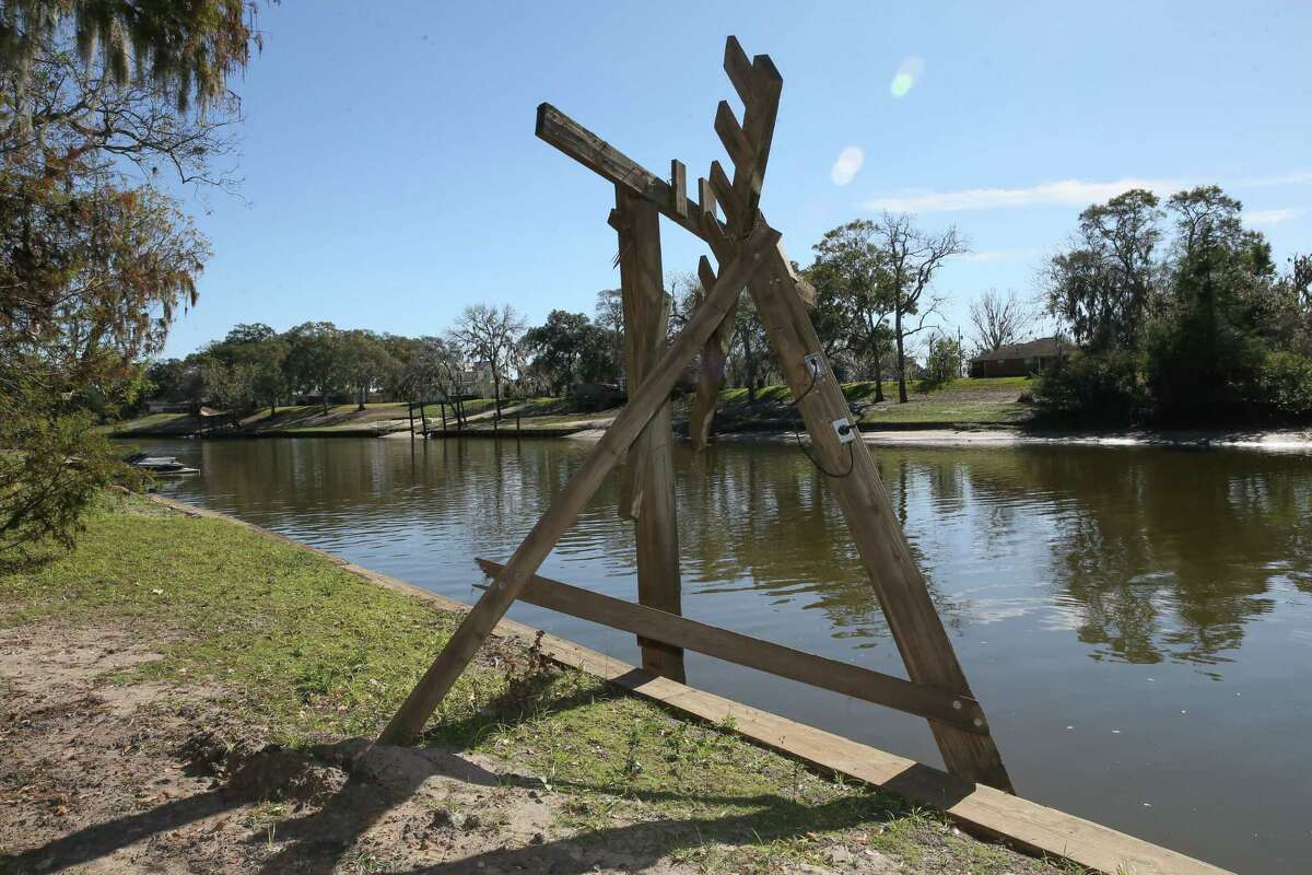 December 10, 2017: Many boat docks sustained severe damage or complete destruction when an unmanned runaway barge ran amok on the San Bernard river in Sweeny, Texas. (Leslie Plaza Johnson/Freelance