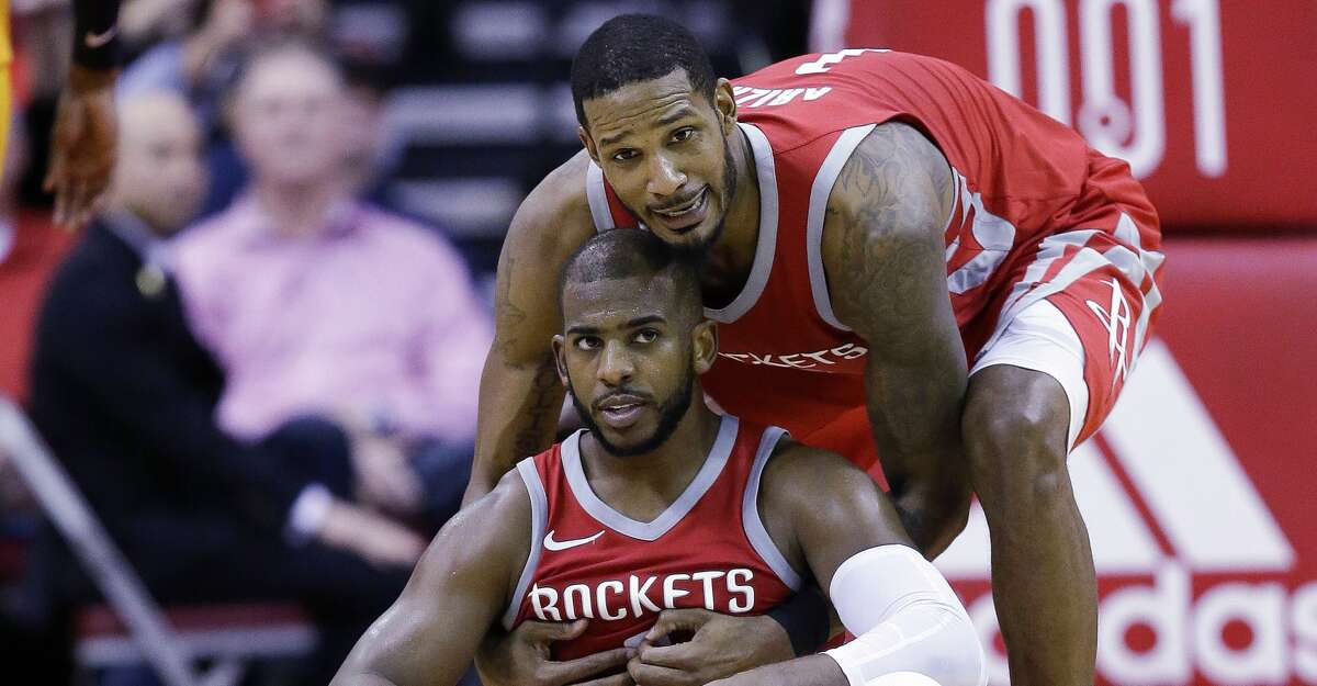 Houston Rockets guard Chris Paul, bottom, is helped up by Trevor Ariza after Paul made a basket and was fouled during the second half of an NBA basketball game against the Utah Jazz, Monday, Dec. 18, 2017, in Houston. Houston won the game 120-99. (AP Photo/Eric Christian Smith)