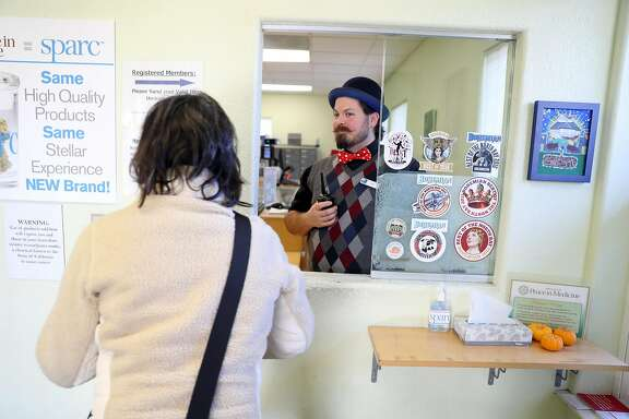 SPARC employee Be Wilson interacts with a customer as preparations are made Jan.1 kickoff of recreational cannabis sales in California at SPARC in Sebastopol, Calif., on Wednsday, December 27, 2017.