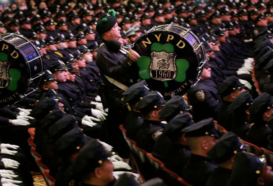A pipe and drum band performs during a Police Academy graduation ceremony at the Beacon Theatre in New York, Thursday, Dec. 28, 2017. The new recruits will join approximately 36,000 other police officers on the largest police force in the United States. (AP Photo/Seth Wenig) Photo: Seth Wenig / Copyright 2017 The Associated Press. All rights reserved.