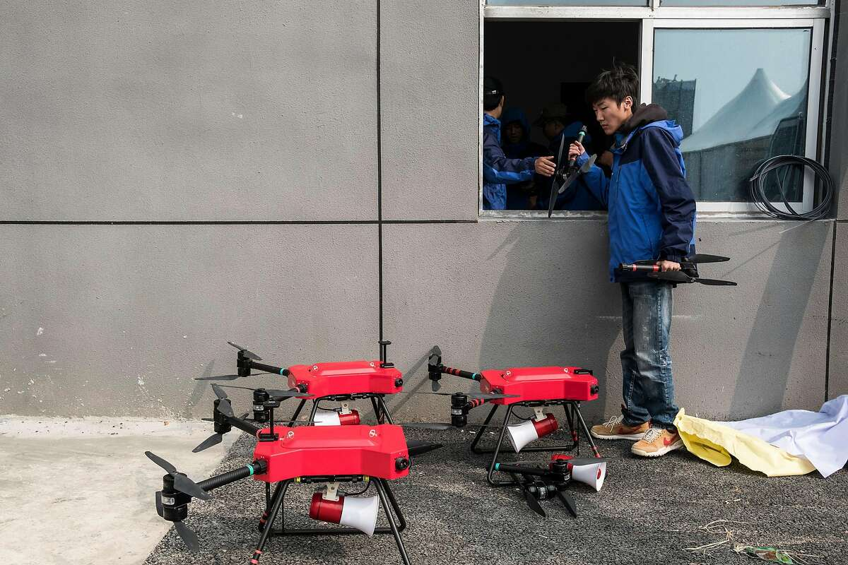 Drones used to sonically repel birds during flight activities at the World Fly-In Expo in Wuhan, China, Nov. 4, 2017. China has become the world leader in drones thanks largely to a single company, DJI, which has grown to account for more than 70 percent of the global market, according to Skylogic Research, a drone research firm. (Lam Yik Fei/The New York Times)