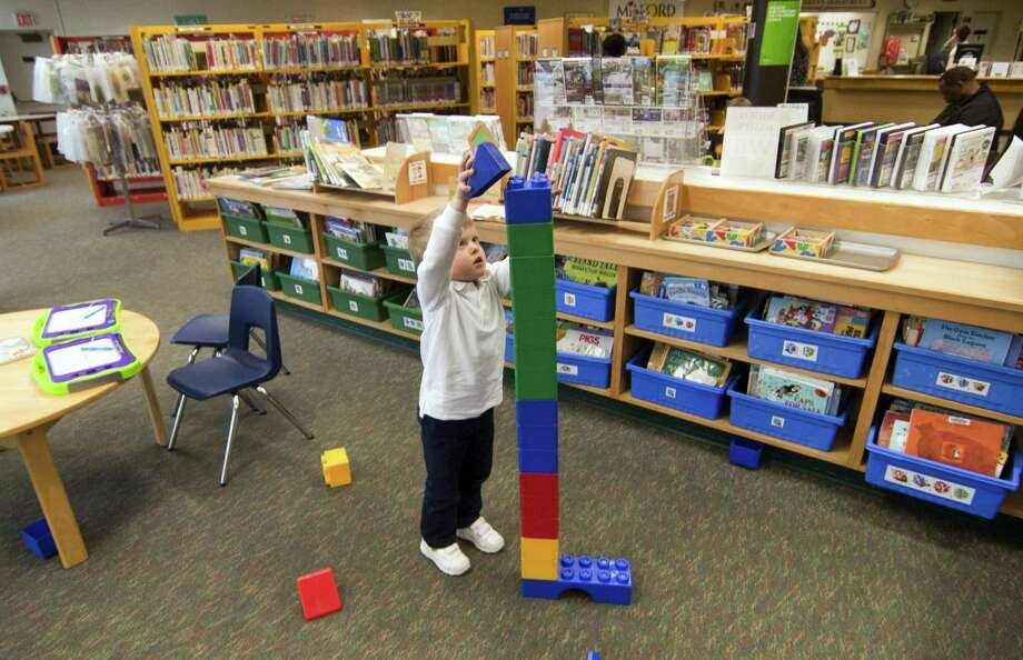 Brennan Lawless, 3, of Milford, builds a Lego tower while playing at the Milford Public Library in Milford, Conn., on Wednesday Nov. 1, 2017. Photo: Christian Abraham / Hearst Connecticut Media / Connecticut Post