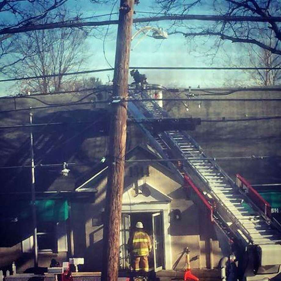 Stratford, Conn., firefighters responded to a blaze Thursday, Dec. 28, 2017,  at a commercial building on Main Street. Dispatch reports said the fire was in the building that the Soap Box Laundromat. Stratford fire officials said the fire started in a dryer duct and eventually made its way to the roof. Photo: Contributed Photo / Stratford Fire Department / Contributed Photo / Connecticut Post Contributed