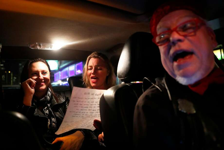 Buzz Brooks' riders' Katrina Holden of Sydney, Australia and Justina Hampered of London sing along in Brooks' Kabaret Kab in San Francisco, Calif., on Thursday, November 30, 2017. Photo: Scott Strazzante, The Chronicle