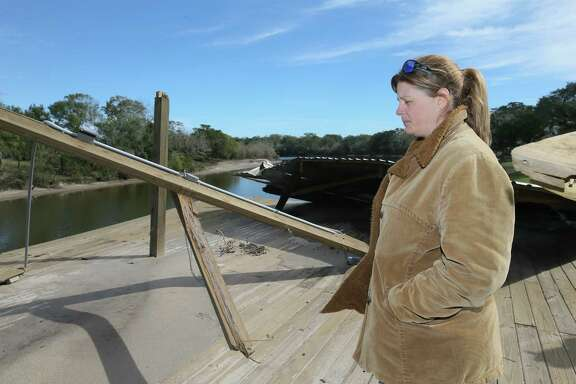 Shelly Stubbs and her Sweeny neighbors have not been able to repair the damage to their boat docks by an unmanned runaway barge during Hurricane Harvey.