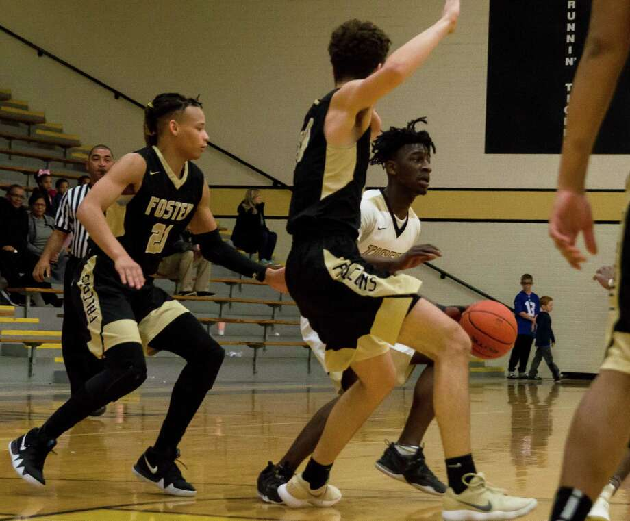 Conroe's Jay Lewis navigates through the defense against Richmond Foster on Thursday at The Pit at Conroe High School. Photo: Keith MacPherson