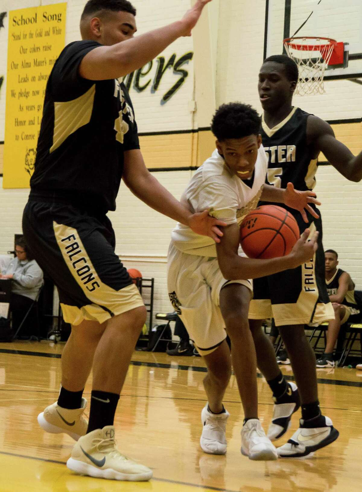 Conroe's Antonio Evans drives to the basket against Richmond Foster on Thursday at The Pit at Conroe High School.