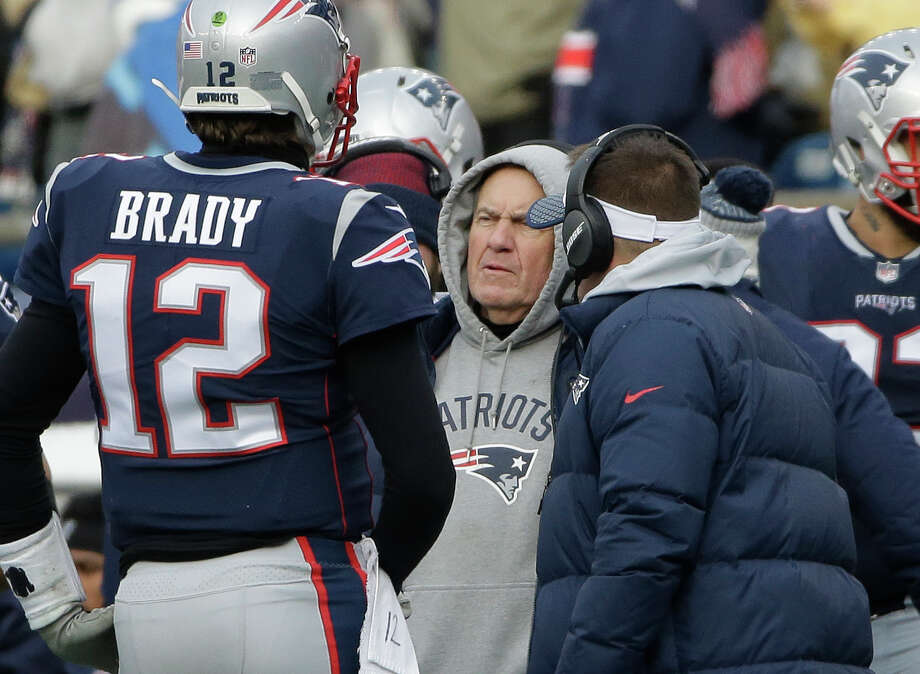 File- This Dec. 24, 2017, file photo shows New England Patriots head coach Bill Belichick, center, speaking to quarterback Tom Brady, left, during a timeout in the first half of an NFL football game in Foxborough, Mass.  Belichick has long said he feels he isn't able to ascertain the identity of his team until after the Thanksgiving holiday. After stumbling out of the gate to begin the season, his team has been among the NFL's most resilient groups in the second half.  (AP Photo/Steven Senne, File) Photo: Steven Senne/Associated Press