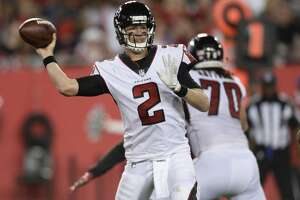 File-This Dec. 18, 2017, file photo shows Atlanta Falcons quarterback Matt Ryan (2) throwing a pass against the Tampa Bay Buccaneers during the first half of an NFL football game, in Tampa, Fla. The NFC South has a chance to make a claim to be the NFL's strongest division with three playoff teams. For the Carolina Panthers, two would be enough. The Atlanta Falcons will try to earn a playoff spot while the Panthers are playing for the division title when the rivals meet Sunday.  (AP Photo/Jason Behnken, File)