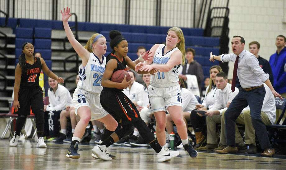 Wilton coach Rob Coloney, at right, reacts as Wilton's Emily Tuin (22) and Claire Gulbin (11) double team Stamford's Brooke Kelly (32) on the trap mid court in a girls basketball game in Wilton, Conn. on Thursday, Dec. 28, 2017. Wilton defeated Stamford 74-56. Photo: Matthew Brown / Hearst Connecticut Media / Stamford Advocate