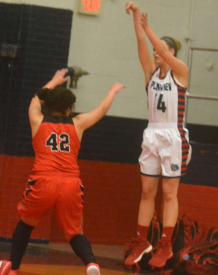 Plainview's Jesse Long takes a jump shot during a game earlier this season. Long scored 18 points Thursday as the Lady Bulldogs defeated Midland Classical at the Chap Center in Midland in their first game in this year's Byron Johnston Holiday Classic. Photo: Skip Leon/Plainview Herald