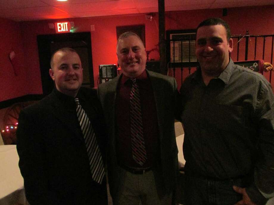 Outgoing Torrington P38 American Legion baseball coach R.J. Poniatoski (center) is surrounded by outgoing assistant coach Eric Mahar (left) and incoming head coach Doug Pergola at the team's annual banquet Thursday night. Photo: Peter Wallace / Hearst Connecticut Media