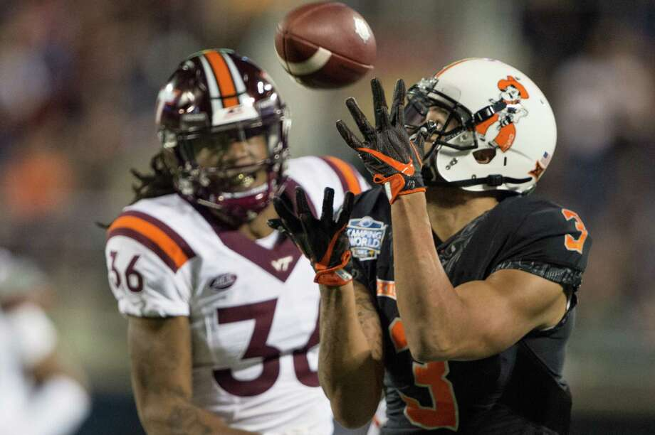ORLANDO, FL - DECEMBER 28: Wide receiver Marcell Ateman #3 of the Oklahoma State Cowboys catches a pass in front of cornerback Adonis Alexander #36 of the Virginia Tech Hokies on December 28, 2017 at Camping World Stadium in Orlando, Florida. (Photo by Michael Chang/Getty Images) Photo: Michael Chang / 2017 Getty Images