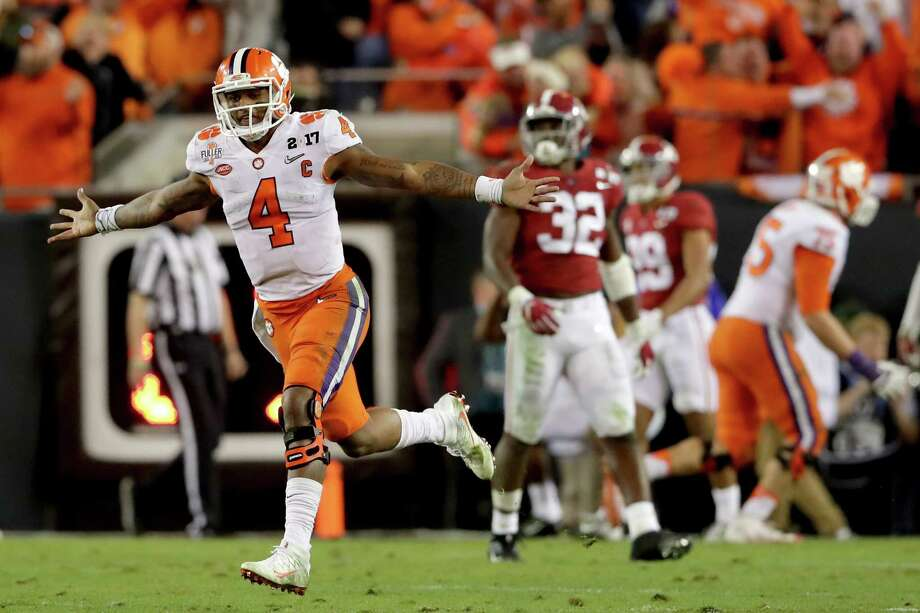 TAMPA, FL - JANUARY 09:  Quarterback Deshaun Watson #4 of the Clemson Tigers celebrates after throwing a 2-yard game-winning touchdown pass during the fourth quarter against the Alabama Crimson Tide to win the 2017 College Football Playoff National Championship Game 35-31 at Raymond James Stadium on January 9, 2017 in Tampa, Florida.  (Photo by Streeter Lecka/Getty Images) ORG XMIT: 686857421 Photo: Streeter Lecka / 2017 Getty Images