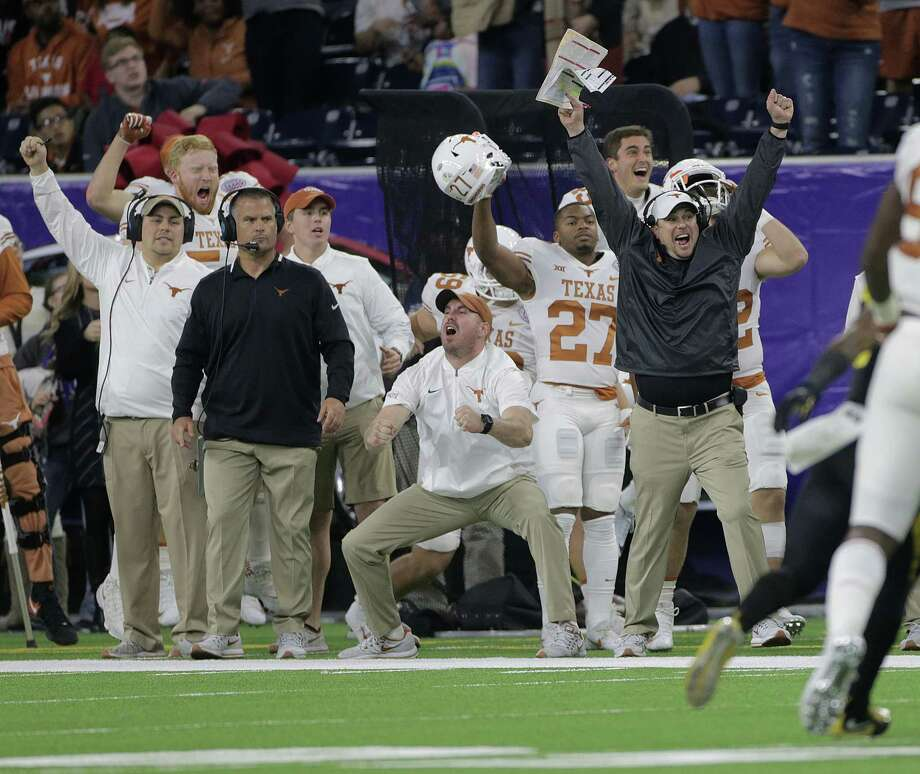No one was happier on the UT sideline than coach Tom Herman, right, when his defense came up with an interception against Missouri on Wednesday night in the Texas Bowl at NRG Stadium. Photo: Elizabeth Conley, Chronicle / © 2017 Houston Chronicle
