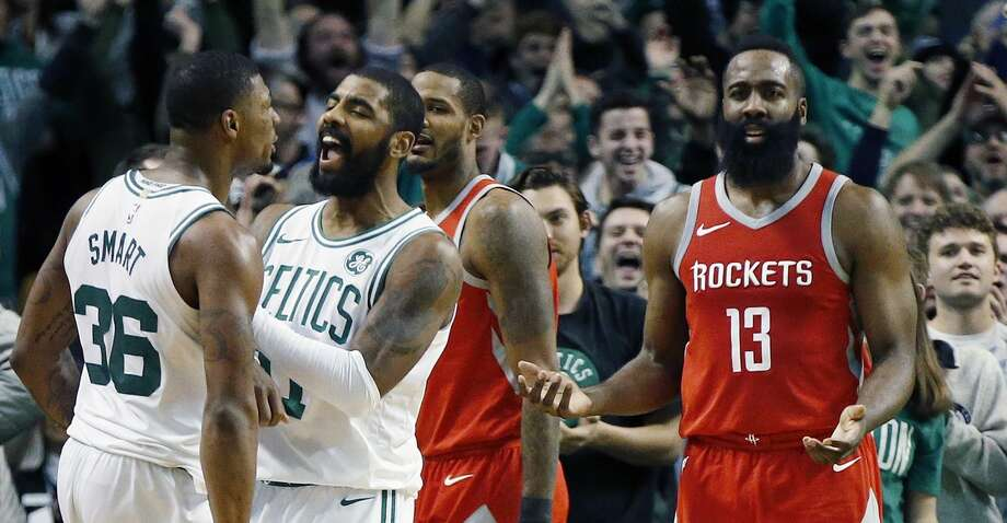 Boston Celtics' Marcus Smart (36) and Kyrie Irving (11) celebrate as Houston Rockets' James Harden (13) reacts during the fourth quarter of an NBA basketball game in Boston, Thursday, Dec. 28, 2017. (AP Photo/Michael Dwyer) Photo: Michael Dwyer/Associated Press