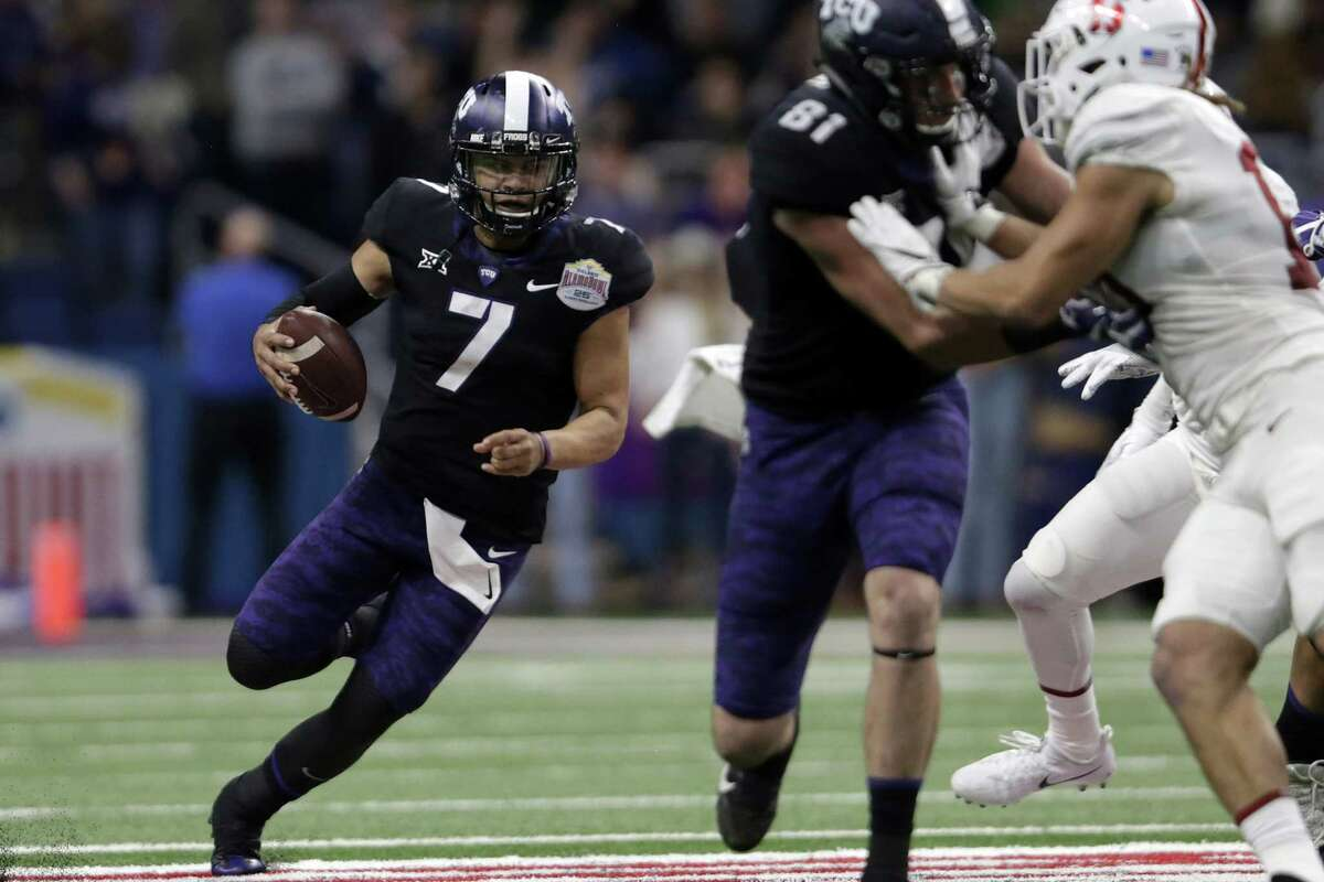 SAN ANTONIO, TX - DECEMBER 28: Kenny Hill #7 of the TCU Horned Frogs scrambles behind the blocking of Cole Hunt #81 in the third quarter against the Stanford Cardinal during the Valero Alamo Bowl at the Alamodome on December 28, 2017 in San Antonio, Texas.