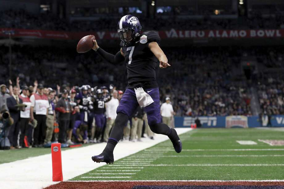 SAN ANTONIO, TX - DECEMBER 28:  Kenny Hill #7 of the TCU Horned Frogs scrambles for a touchdown in the second quarter against the Stanford Cardinal during the Valero Alamo Bowl at the Alamodome on December 28, 2017 in San Antonio, Texas. Photo: Tim Warner, Getty Images / 2017 Getty Images