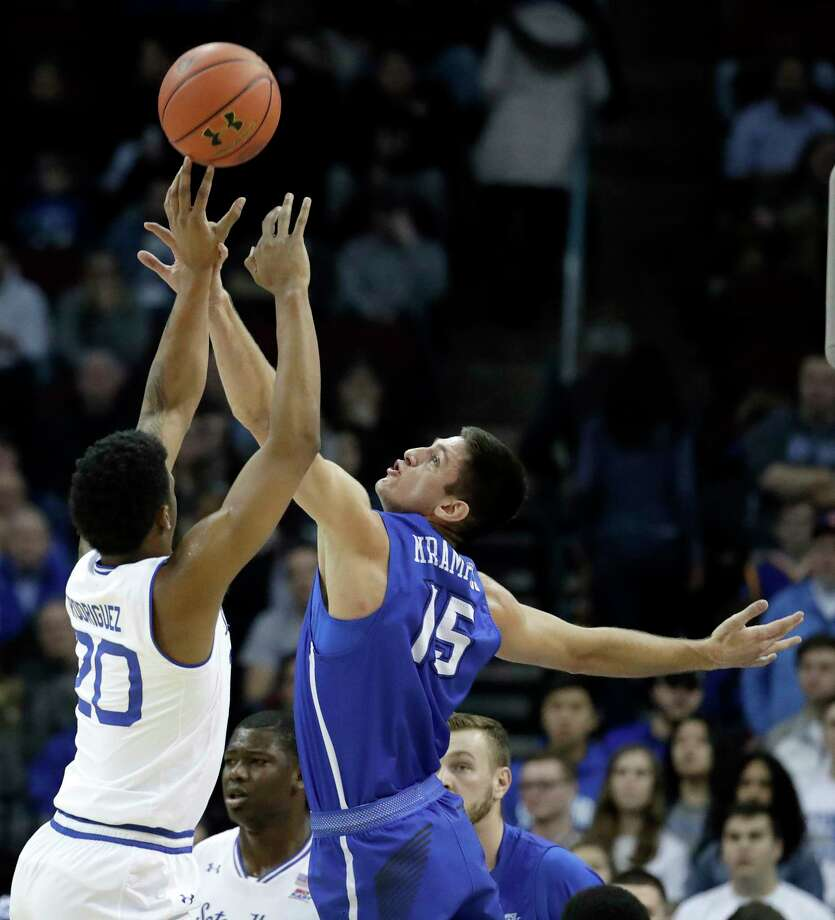 Seton Hall Pirates forward Desi Rodriguez (20) goes up to shoot against Creighton forward Martin Krampelj (15) during the first half of an NCAA college basketball game, Thursday, Dec. 28, 2017, in Newark, N.J. (AP Photo/Julio Cortez) Photo: Julio Cortez / Copyright 2017 The Associated Press. All rights reserved.