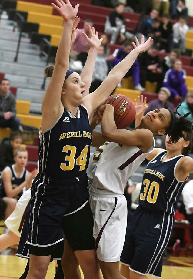 Averill Park's Kelsey Wood, #34, guards Colonie's Kyara Triblet as she drives to the hoop during a basketball game on Thursday, Dec. 28, 2017 in Colonie, N.Y. This was the Colonie Holiday Tournament girls' basketball final. (Lori Van Buren / Times Union) Photo: Lori Van Buren / 20042513A