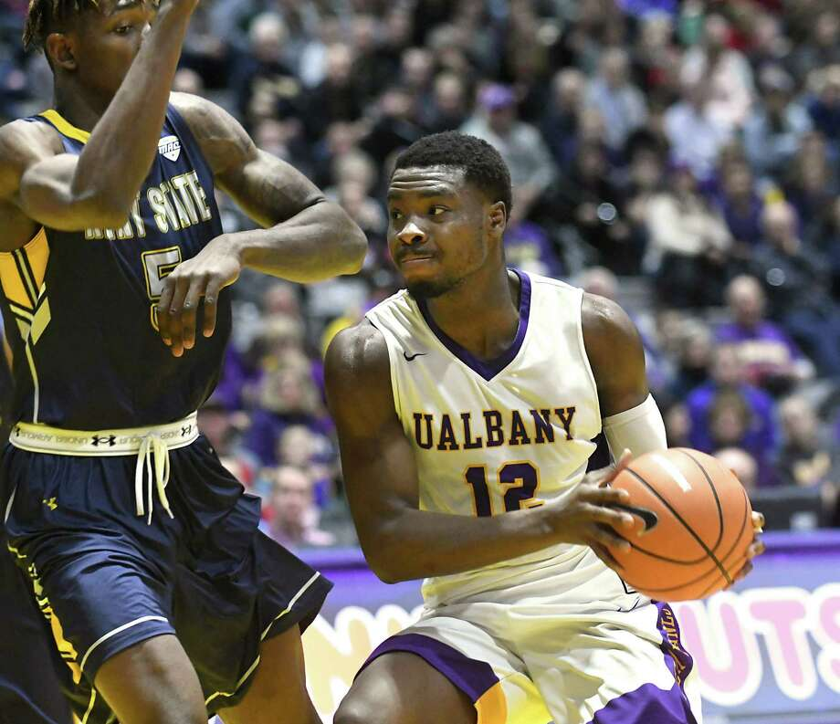 University at Albany's Devonte Campbell is guarded by Kent State's Danny Pippen as he drives to the hoop during a basketball game at SEFCU Arena on Thursday, Dec. 28, 2017 in Albany, N.Y.  (Lori Van Buren / Times Union) Photo: Lori Van Buren / 20042315A