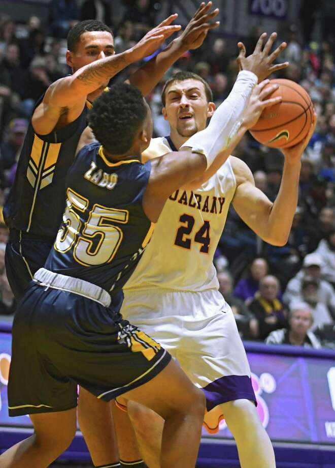 University at Albany's Joe Cremo looks for an open man during a basketball game against Kent State at SEFCU Arena on Thursday, Dec. 28, 2017 in Albany, N.Y.  (Lori Van Buren / Times Union) Photo: Lori Van Buren / 20042315A