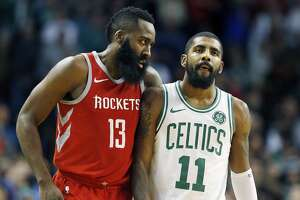 Houston Rockets' James Harden (13) follows Boston Celtics' Kyrie Irving (11) upcourt following a timeout during the fourth quarter of an NBA basketball game in Boston, Thursday, Dec. 28, 2017. (AP Photo/Michael Dwyer)