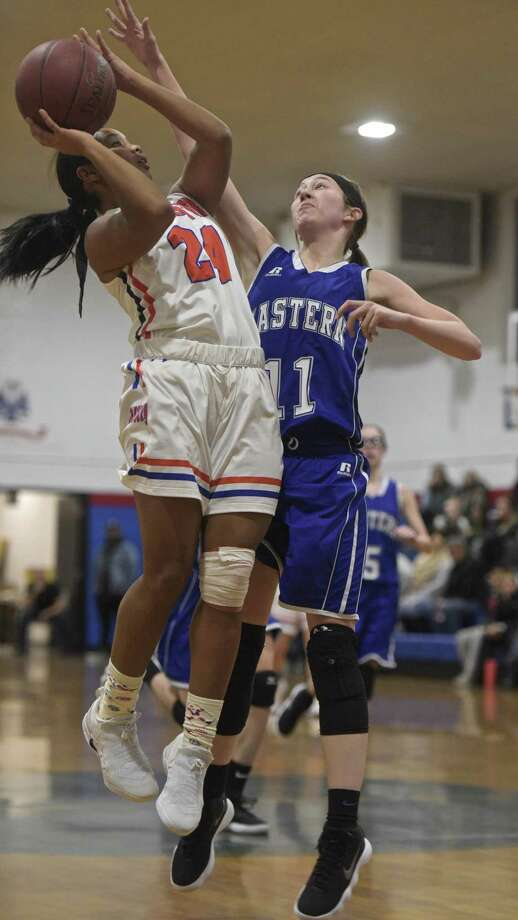 Danbury's Ty'Lynn Ith (24) goes up for a shot over Bristol Eastern's Hannah Maghini in the championship game of the Greater Danbury Holiday Festival Thursday at the Danbury War Memorial. Photo: H John Voorhees III / Hearst Connecticut Media / The News-Times