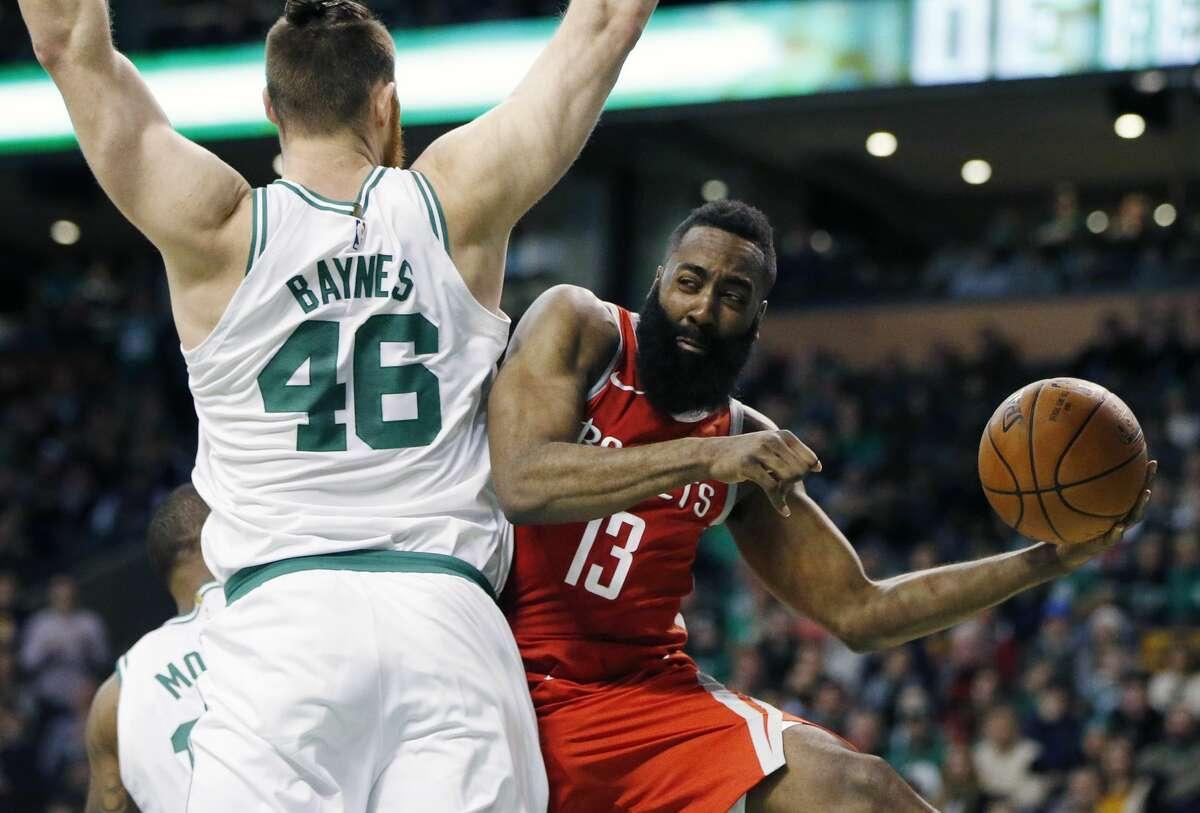 Houston Rockets' James Harden (13) passes off behind Boston Celtics' Aron Baynes (46) during the fourth quarter of an NBA basketball game in Boston, Thursday, Dec. 28, 2017. The Celtics won 99-98. (AP Photo/Michael Dwyer)