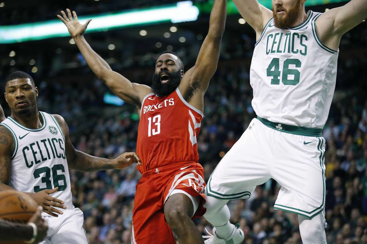 Houston Rockets' James Harden (13) loses control of the ball against Boston Celtics' Marcus Smart (36) and Aron Baynes (46) during the third quarter of an NBA basketball game in Boston, Thursday, Dec. 28, 2017. The Celtics won 99-98. (AP Photo/Michael Dwyer)