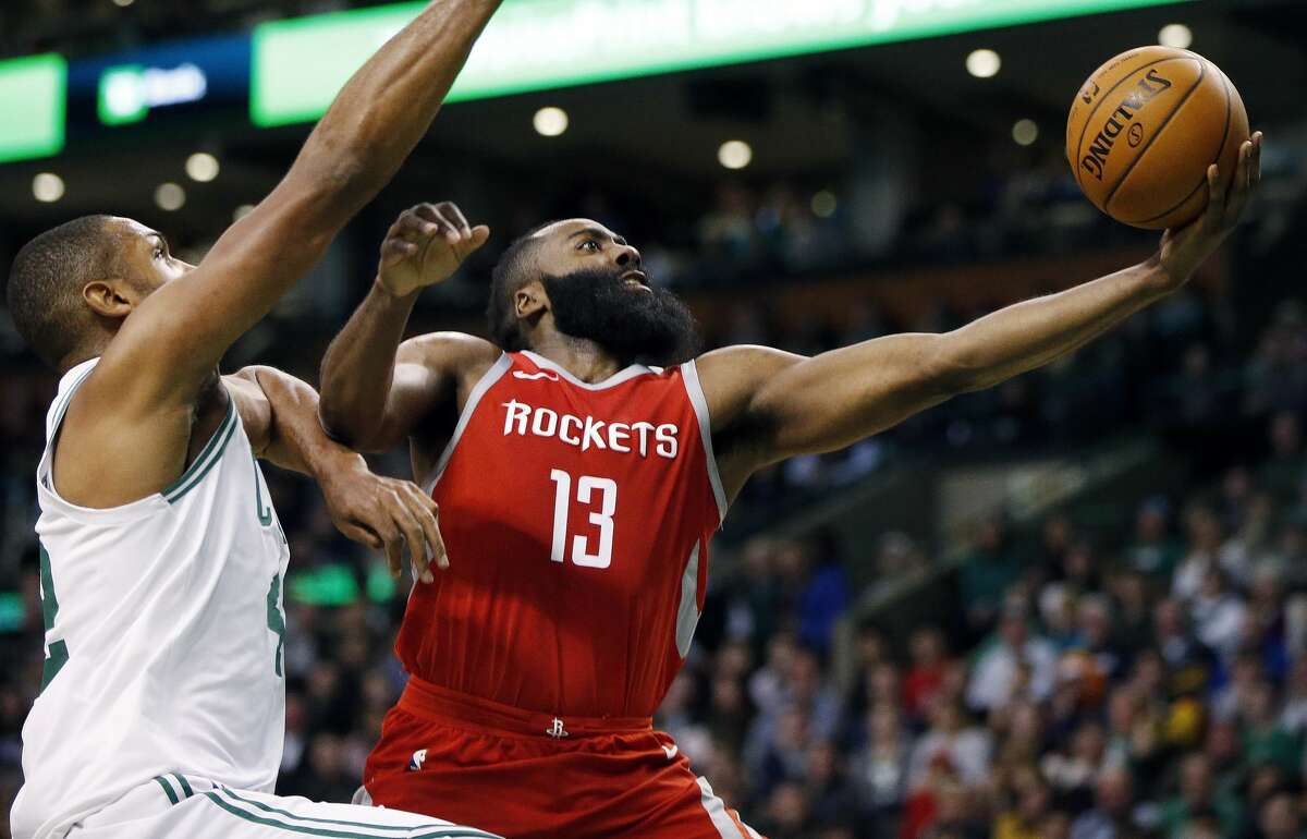 Houston Rockets' James Harden (13) shoots in front of Boston Celtics' Al Horford during the third quarter of an NBA basketball game in Boston, Thursday, Dec. 28, 2017. (AP Photo/Michael Dwyer)