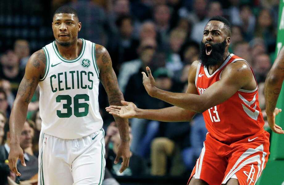 Rockets guard James Harden, right, pleads his case to the officials following a first-quarter call with the Celtics' Marcus Smart looking on Thursday night. Harden later was whistled for a pair of game-turning offensive calls against Smart. Photo: Michael Dwyer, STF / AP2017