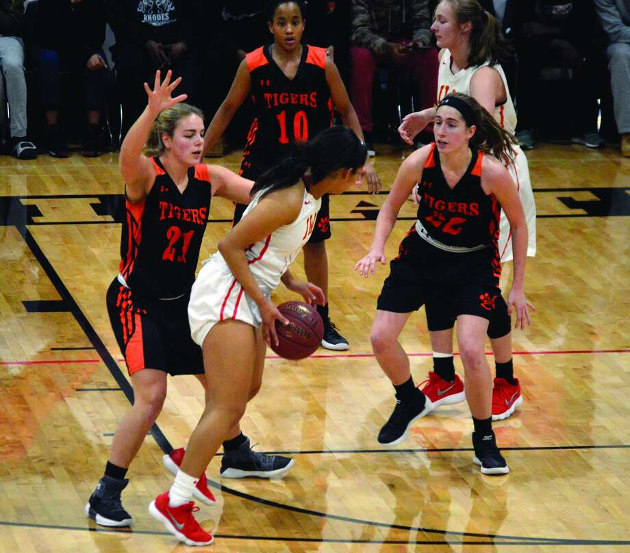 Edwardsville's Rachel Pranger, left, and Kate Martin play defense against Incarnate Word.