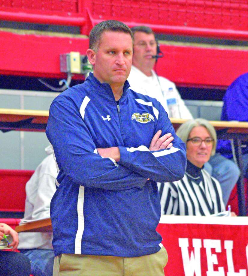 Father McGivney coach Rich Beyers watches his team during Tuesday's game against Shelbyville at the Vandalia Holiday Tournament.