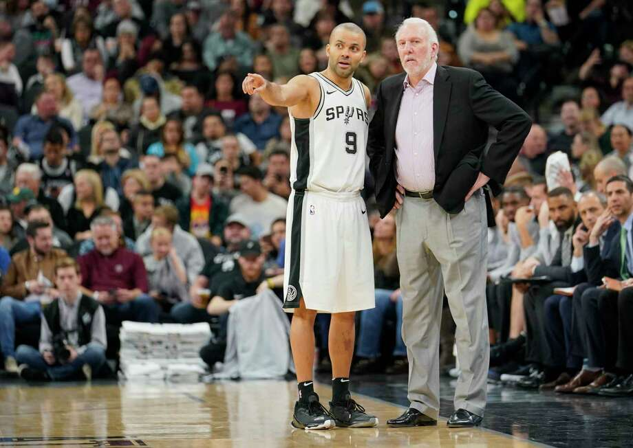 San Antonio Spurs head coach Gregg Popovich, right, talks with Spurs guard Tony Parker during the second half of an NBA basketball game against the New York Knicks, Thursday, Dec. 28, 2017, in San Antonio. San Antonio won 119-107. (AP Photo/Darren Abate) Photo: Darren Abate, Associated Press / FR115 AP