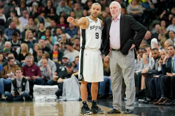 San Antonio Spurs head coach Gregg Popovich, right, talks with Spurs guard Tony Parker during the second half of an NBA basketball game against the New York Knicks, Thursday, Dec. 28, 2017, in San Antonio. San Antonio won 119-107. (AP Photo/Darren Abate)