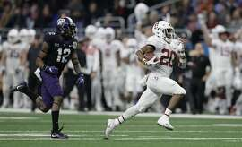 Stanford running back Bryce Love (20) is pursued by TCU cornerback Jeff Gladney (12) as he runs for a touchdown during the second half of the Alamo Bowl NCAA college football game Thursday, Dec. 28, 2017, in San Antonio. (AP Photo/Eric Gay)