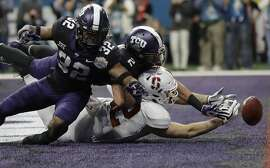 TCU linebacker Travin Howard (32) and safety Niko Small (2) break up a pass intended for Stanford tight end Kaden Smith (82) during the second half of the Alamo Bowl NCAA college football game, Thursday, Dec. 28, 2017, in San Antonio. (AP Photo/Eric Gay)