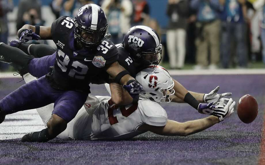 TCU linebacker Travin Howard (32) and safety Niko Small break up a pass intended for Stanford tight end Kaden Smith during the second half of the Cardinal's Alamo Bowl loss. Photo: Eric Gay, Associated Press
