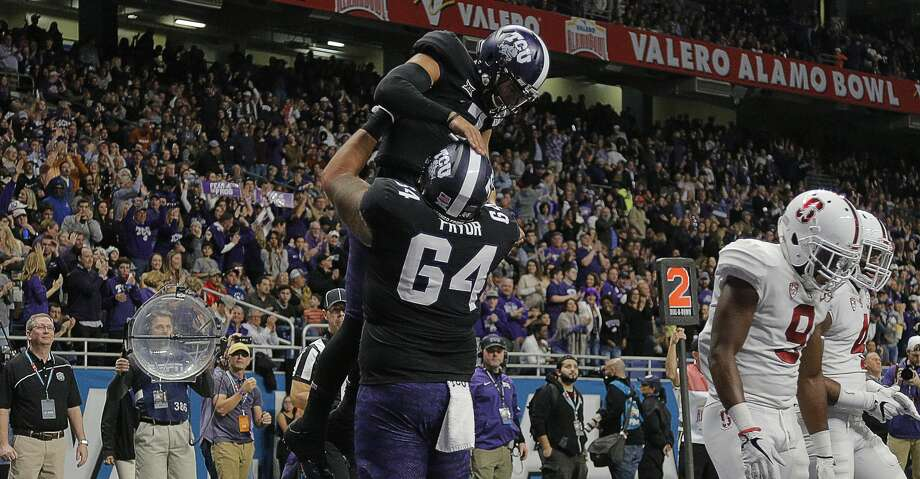 Texas Christian quarterback Kenny Hill (7) celebrates with guard Matt Pryor (64) after running for a touchdown in the second quarter against Stanford in the Valero Alamo Bowl at the Alamodome in San Antonio, Texas, on Thursday, Dec. 28, 2017. (Rodger Mallison/Fort Worth Star-Telegram/TNS) Photo: Rodger Mallison/TNS