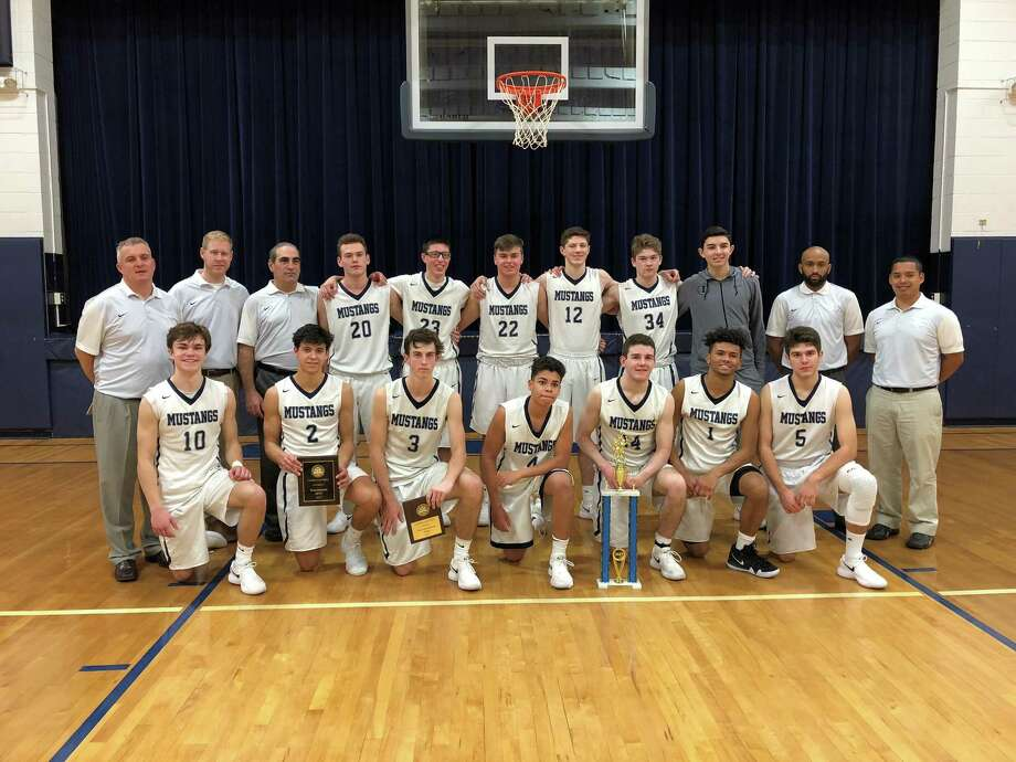 The Immaculate High School boys basketball team following its victory over Brookfield in the championship game of the Candlewood Valley Classic tournament, Dec. 28, 2017. Photo: Contributed Photo / Contributed Photo
