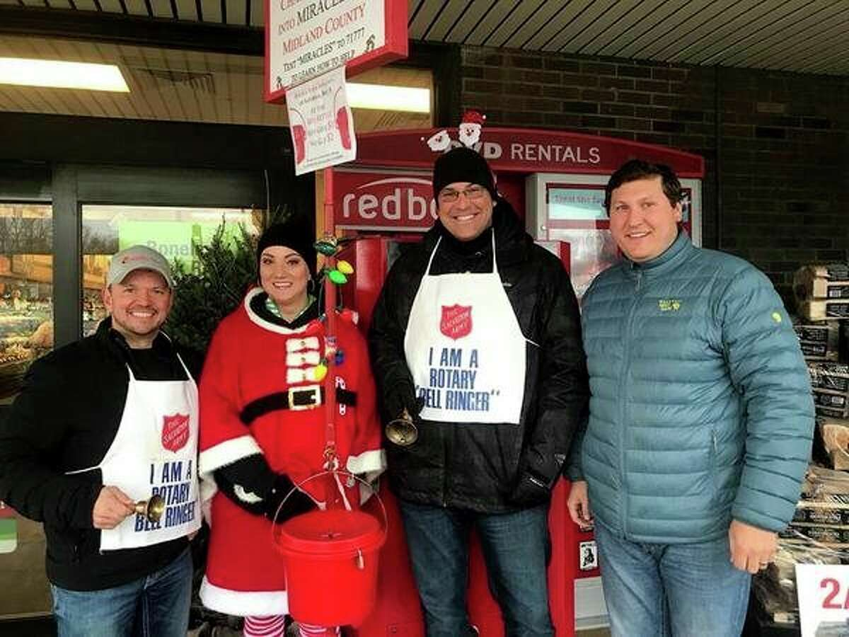 Matt Smith, Amanda Oster, Patrick Schefsky and Blain Anderson ring bells Dec. 2 with the Midland Noon Rotary, to benefit the Salvation Army. (Photo provided)