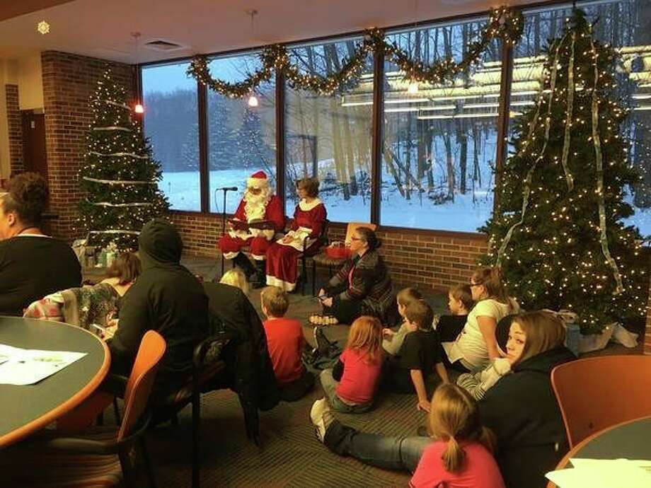 The employees at Mid Michigan Community College took time this year to help area children have a merry Christmas. (Photo provided)