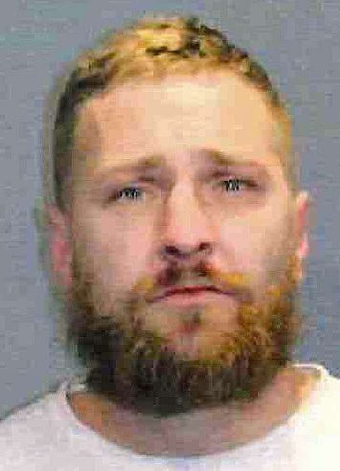 Timothy Michael Ryan, 38, of North Street in West Haven, was arrested on charges of operating under the influence of drugs/alcohol and driving the wrong way on a divided highway. State Police say Ryan was driving the wrong way on Route 8 in Waterbury on Dec. 27, 2017 when his vehicle struck a vehicle head-on. Another vehicle then struck the vehicle hit by Ryan's vehicle. Four people were taken to the hospital. Photo: State Police Photo