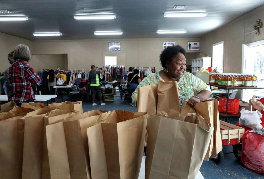Volunteer Felecia Powell gathers items at the Leon County Food Pantry and Clothes Closet on Wednesday, Dec. 20, 2017, in Jewett, Texas. Photo: Jon Shapley, Staff Photographer / © 2017 Houston Chronicle