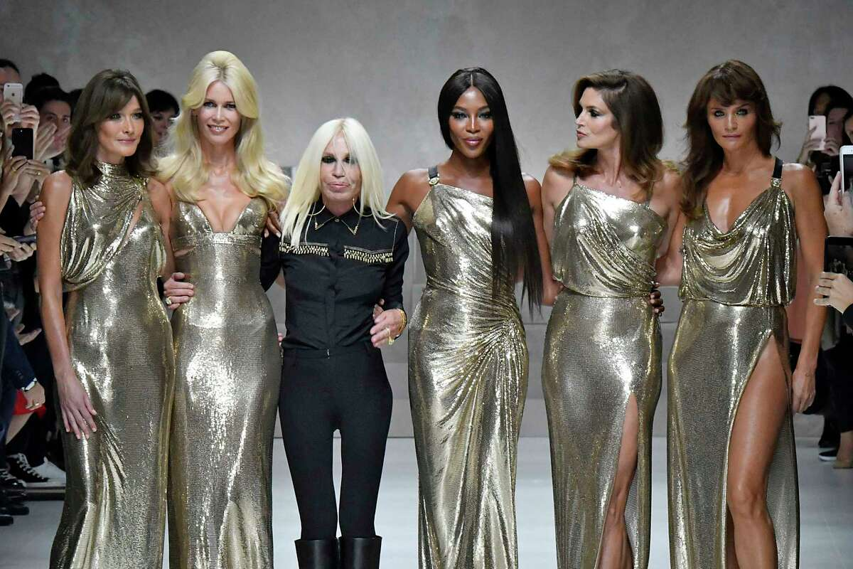 The original super models Carla Bruni, Claudia Schiffer, Donatella Versace, Naomi Campbell, Cindy Crawford and Helena Christensen looked like shimmering goddesses as they appeared on the Versace runway at Milan Fashion Week for the 20th anniversary of Gianni Versace's death. The five women all modeled in the 1980s and '90s for the late designer, who was murdered in July 1997 in Miami.
