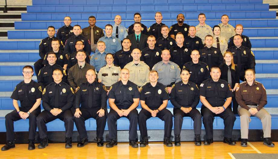 The Southwestern Illinois College Police Academy recently celebrated the graduation of Session 134. The SWIC Police Academy is an intensive academic and physical training program designed to prepare recruits to enter a career in law enforcement. It is one of only six police academies in Illinois. Graduates include, from left, front row: Dalton J. Archer (of Wood River) of the Southern Illinois University Edwardsville Police Department, Jack H. Asquini of the Moline Police Department, Andrew D. Belanger of the Lake Bluff Police Department, Kyle P. Boudreau of the Onarga Police Department, Larry E. Bowles (of East Alton) of the Southern Illinois University Edwardsville Police Department, Carolina Carrillo of the Macomb Police Department, Aaron M. Castros of the Shawneetown Police Department, Summer B. Clapp (of Metropolis) of the Massac County Sheriff's Office – winner Best Defense Tactics Award Andrew J. Compton of the Moline Police Department, Cody R. Daily (of Granite City) of the Southwestern Illinois College Public Safety Department (not pictured), Mason T. Dixon (of Walworth, Wisc.) of the McHenry County Conservation District Police, Kristina A. Draege (of Woodlawn) of the Jefferson County Sheriff's Office – winner Academic Honors Award, Robert J. Fernandez of the Waterloo Police Department – winner Third Place Firearms Award, Eric J. Gott of the Harrisburg Police Department – winner Best Over all in Physical Fitness Award, Silas E. Greening of the Pittsfield Police Department, Amanda J. Heitz (of Plainfield) of the Vermilion County Metropolitan Enforcement Group  Third row:, Anthony L. Hettinger (of Glen Carbon) of the Southern Illinois University Edwardsville Police Department, Adam J. Horn of the Lake Bluff Police Department, Dustin M. Johnson (of O'Fallon) of the Southwestern Illinois College... Photo: For The Intelligencer